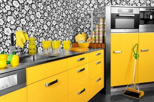 yellow kitchen cabinets with black and white floral wall